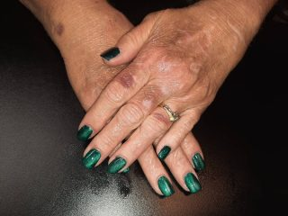 Green cat's eye gel polish.  Manicure with gel $22  Message me or text 321-848-6789 for an appointment